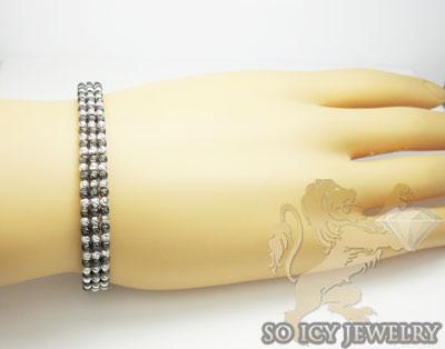Ladies 14k black & white gold fancy 3 row bangle bracelet