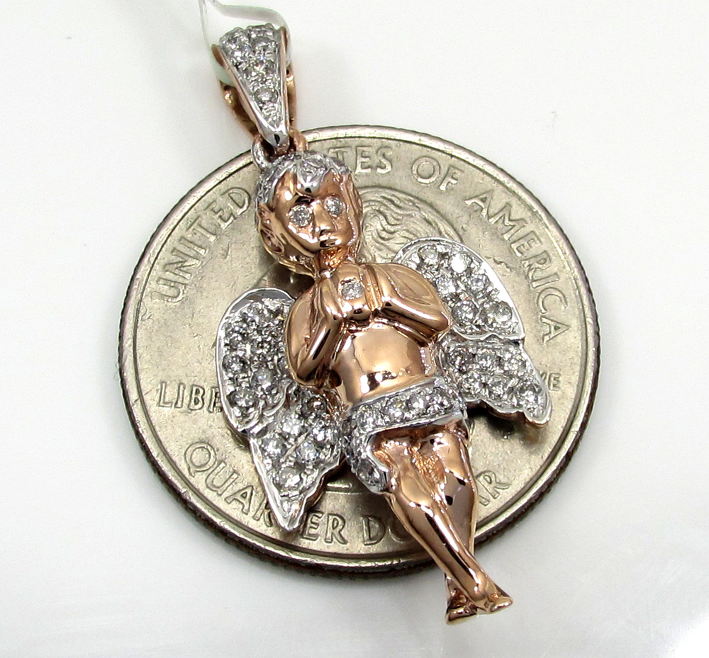 10k white, yellow, and rose gold diamond angel pendant 0.60ct