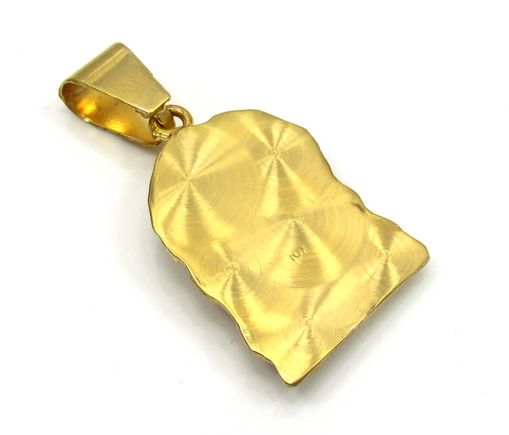 10k yellow gold mini jesus face solid back  pendant .28ct