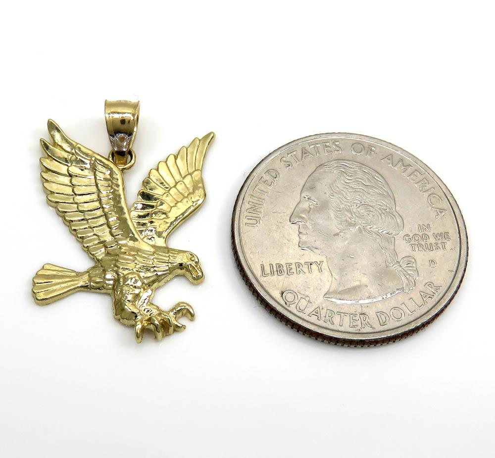 10k yellow gold mini diamond cut eagle pendant